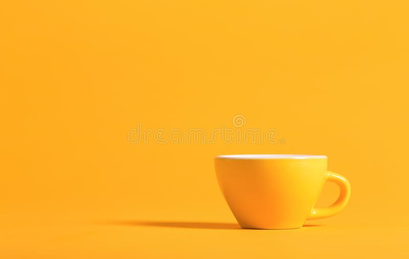 Little teacup on a bright background stock images