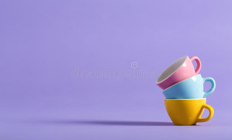 Little teacups on a bright background stock images