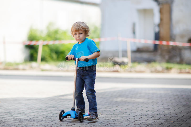 Download Little Toddler Boy Riding On His Bycicle In Summer Stock Image - Image: 33857885