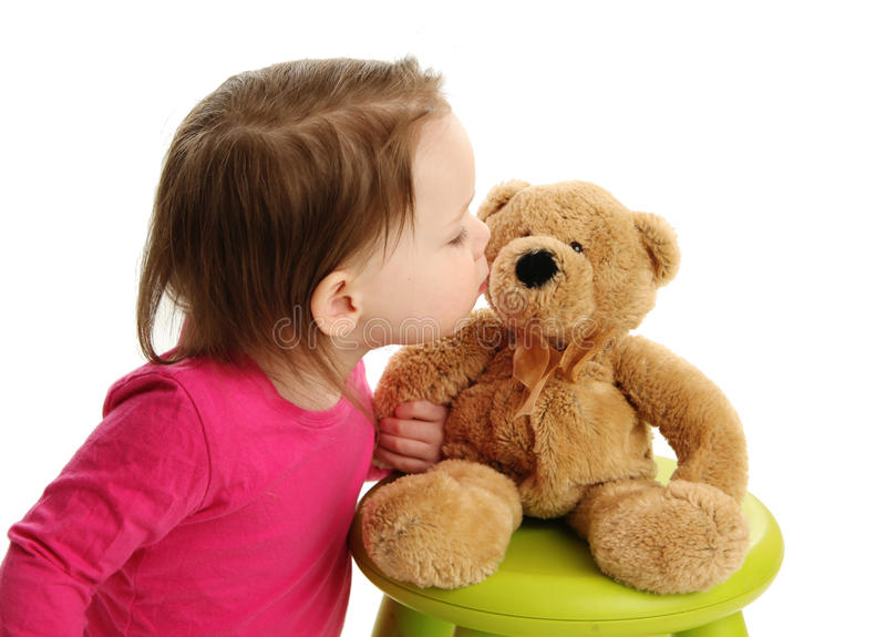 Download Little Toddler Girl Kissing A Teddy Bear Stock Photo - Image: 30367406