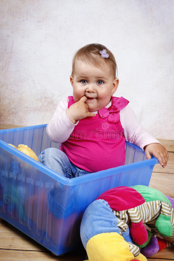 Little toddler thinking about something stock photography