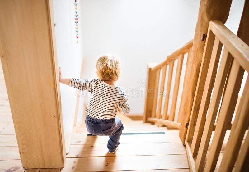 Toddler boy in dangerous situation at home. Child safety concept. royalty free stock images
