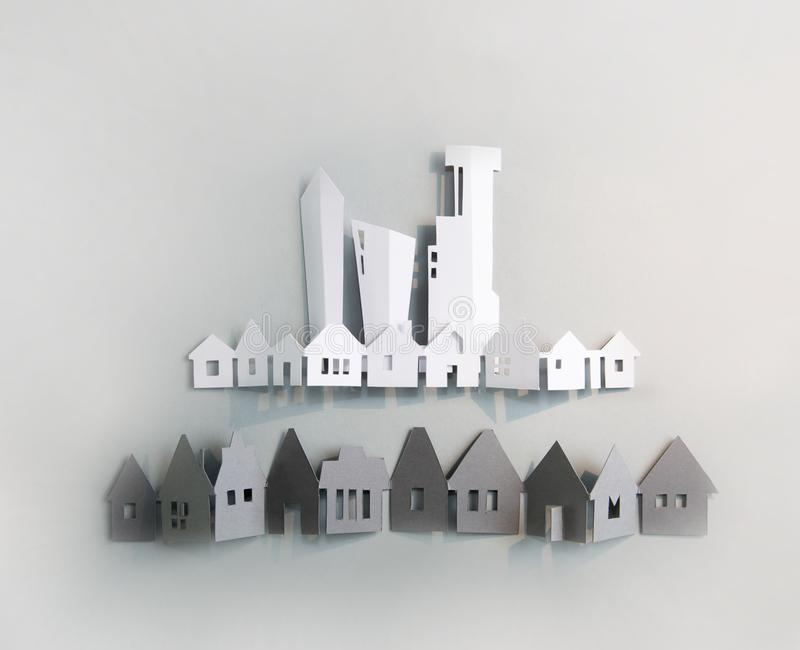 Little town houses in row. Property and house buying concept. Paper cut design background. royalty free stock photography