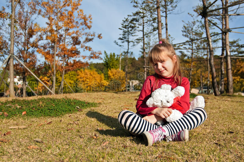 Download Little with toy bear stock photo. Image of little, ground - 24618496