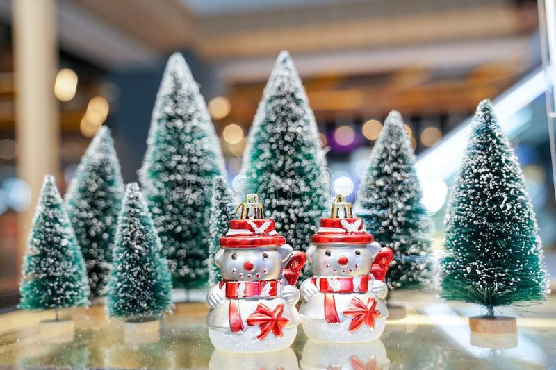Little 2 toy Snowmans stand front of the Christmas trees. Little 2 toy Snowmans stand front of the Christmas  trees royalty free stock photo