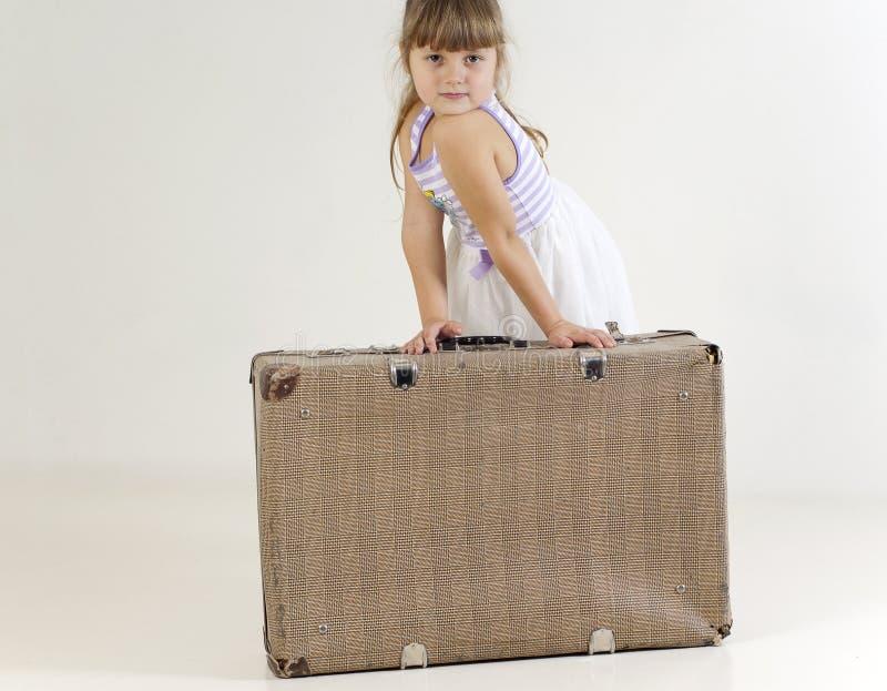 Little traveler girl stock photo