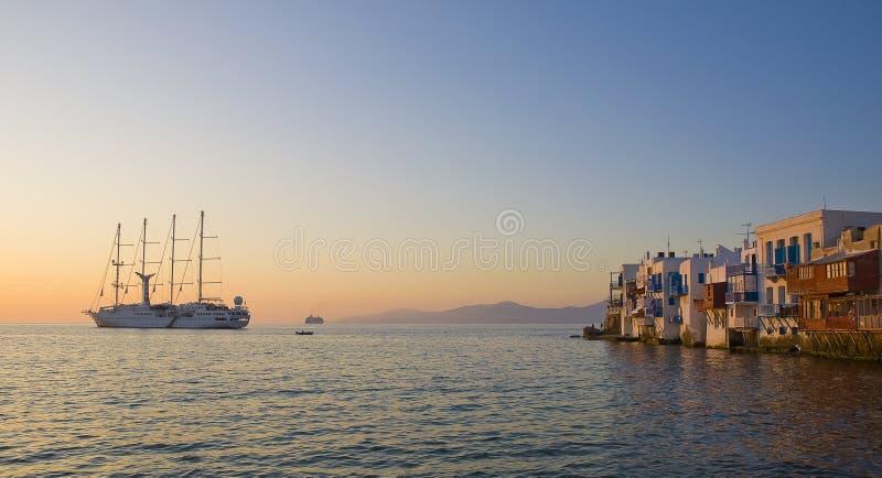Little Venice on Mykonos at sunset. Little Venice on Mykonos and the cruise boat at sunset stock photo