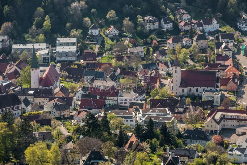 Little village in the middle of the german countryside with a church and half-timber houses and green trees.  stock photo