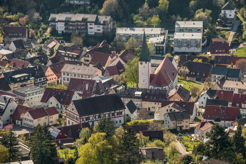 Little village in the middle of the german countryside with a church and half-timber houses and green trees.  royalty free stock image