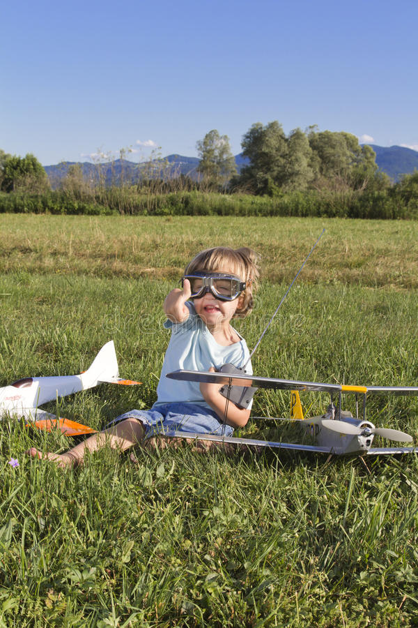 The little villain boy and his new RC plane