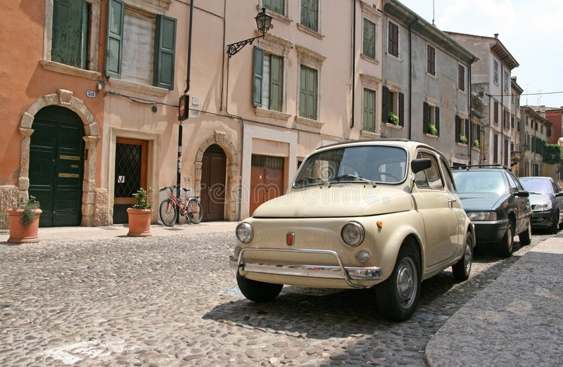 Little vintage Fiat car. On the street of Verona royalty free stock image