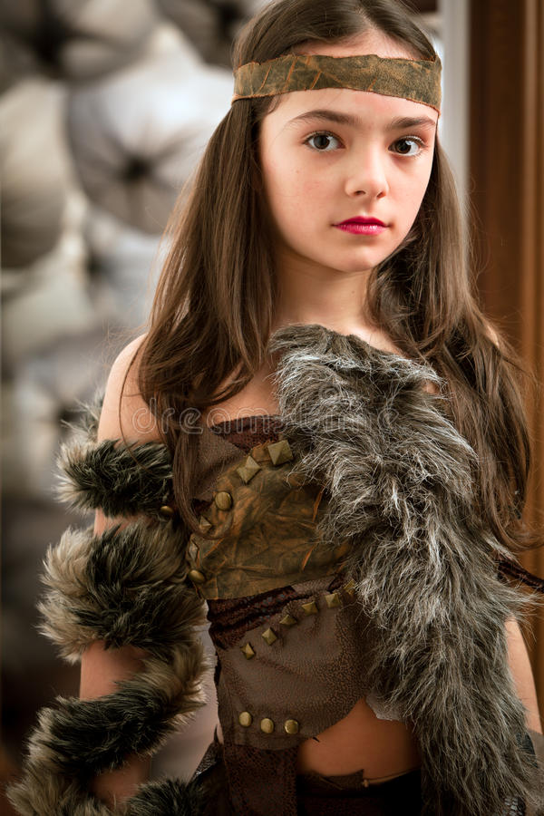 Little warrior. Portrait on a lovely girl in a warrior costume. See other images stock photos