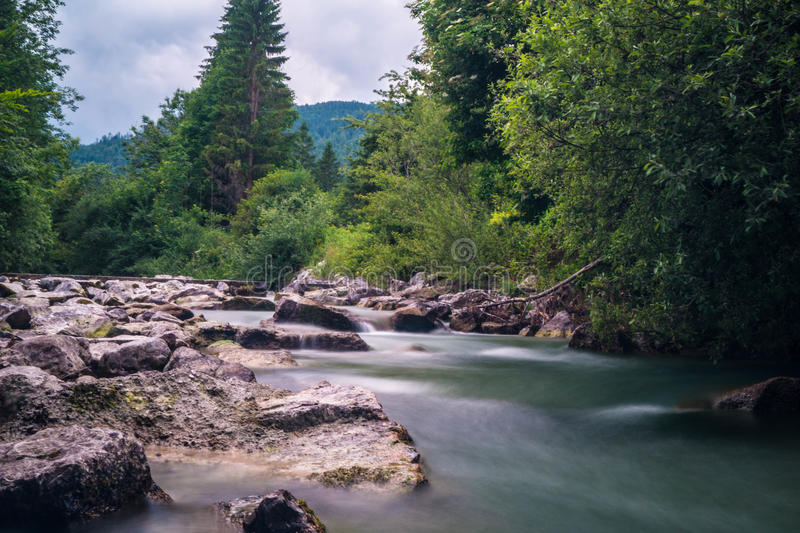 Little Waterfall in sparkling river stock image