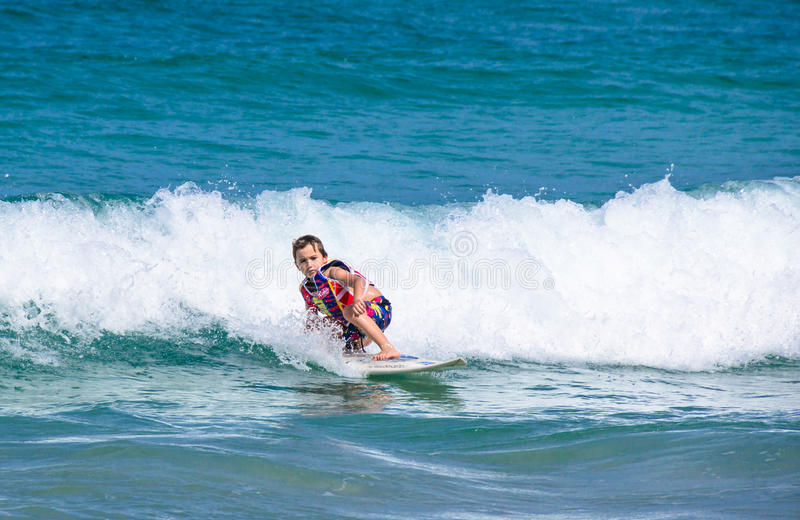 A little Western boy practicing surfing stock photos