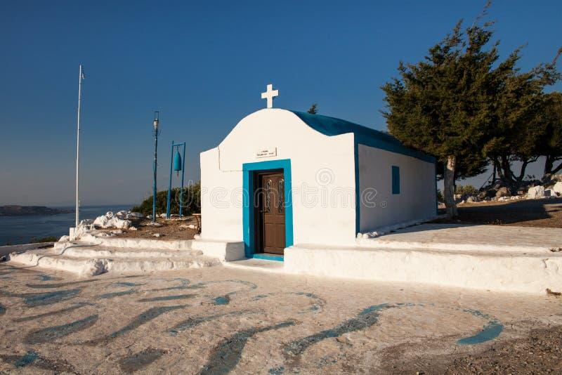 Little white chapel on the hill. Small church in Faliraki. stock image