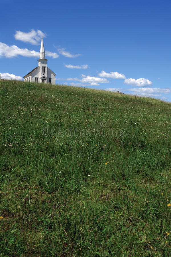 Little white church over the hill royalty free stock image