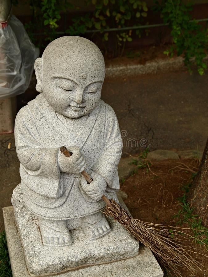 Little White Stone Monk Statue Sweeping The Floor Stock Images