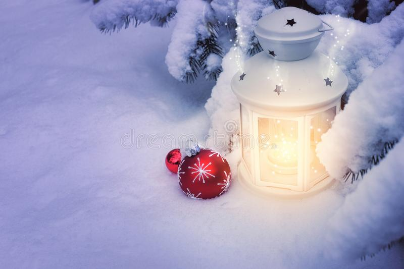 Little winter lanterns outdoors on a Christmas tree under snow, stock photos