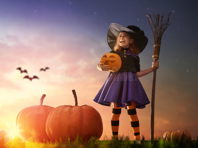 Little witch outdoors stock photo
