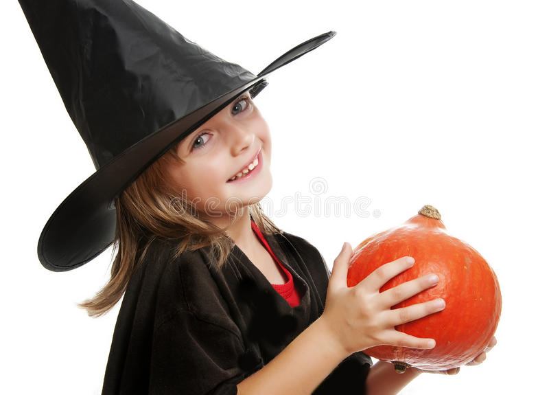 Little Witch With Pumpkin Royalty Free Stock Image