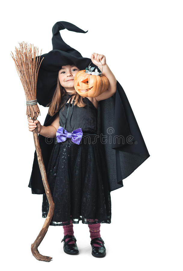 Little witch shows the collected candy royalty free stock image