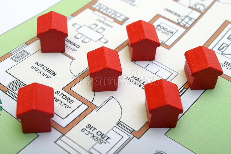 Little wood houses on a plan stock photo