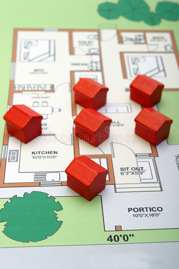 Little wood houses on a plan stock photography