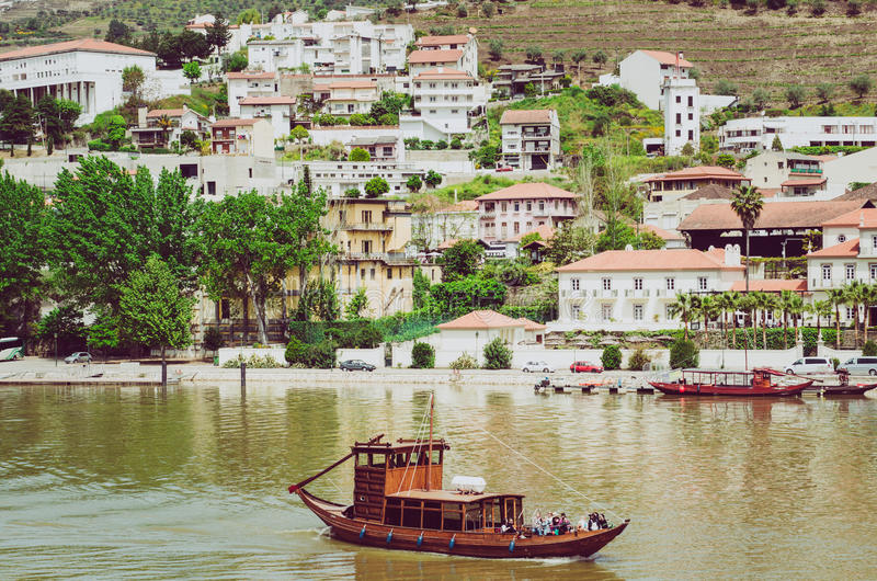 Little wooden boat on Duoro river in Pinhao,Portugal. View from Pinho vilage in Portugal to Douro valey - Photo by Marianarbh1. Little wooden boat on Duoro river royalty free stock photo