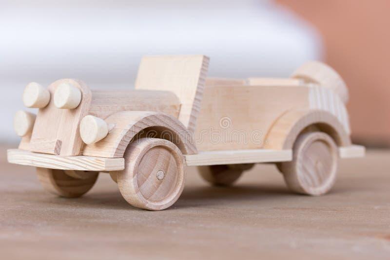 Little wooden car model. A little wooden car model royalty free stock image
