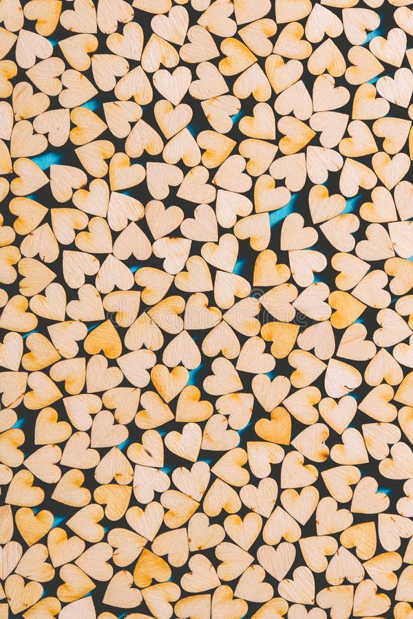 Little wooden hearts on blue background royalty free stock image