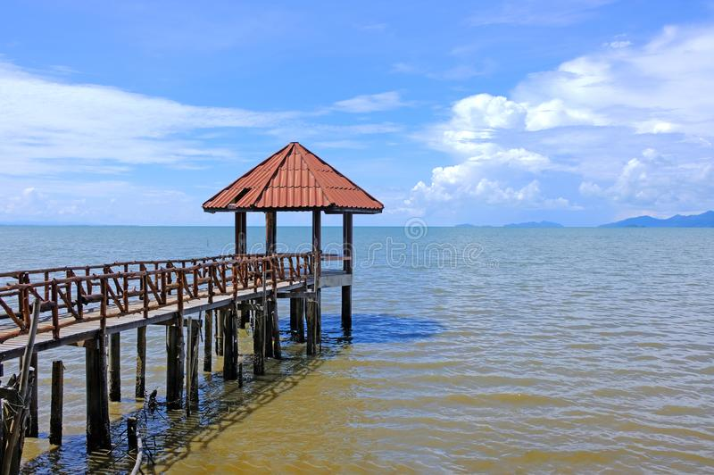 Little wooden pavilion and walkway leading to ocean stock photo
