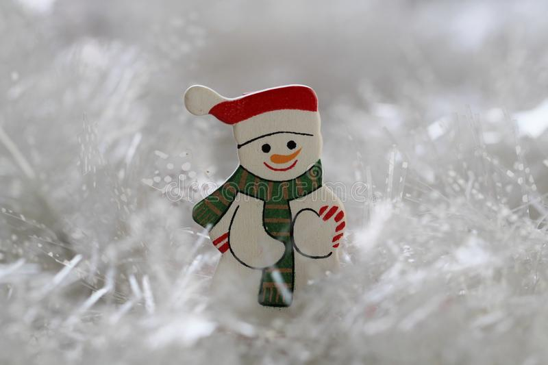 Little wooden snowman stock image