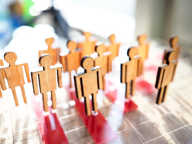 Little wooden toy people figures stand in row. Closeup. Teambuild hr poll net elector politics crowdfunding relationship labour talent public opinion concept stock photos