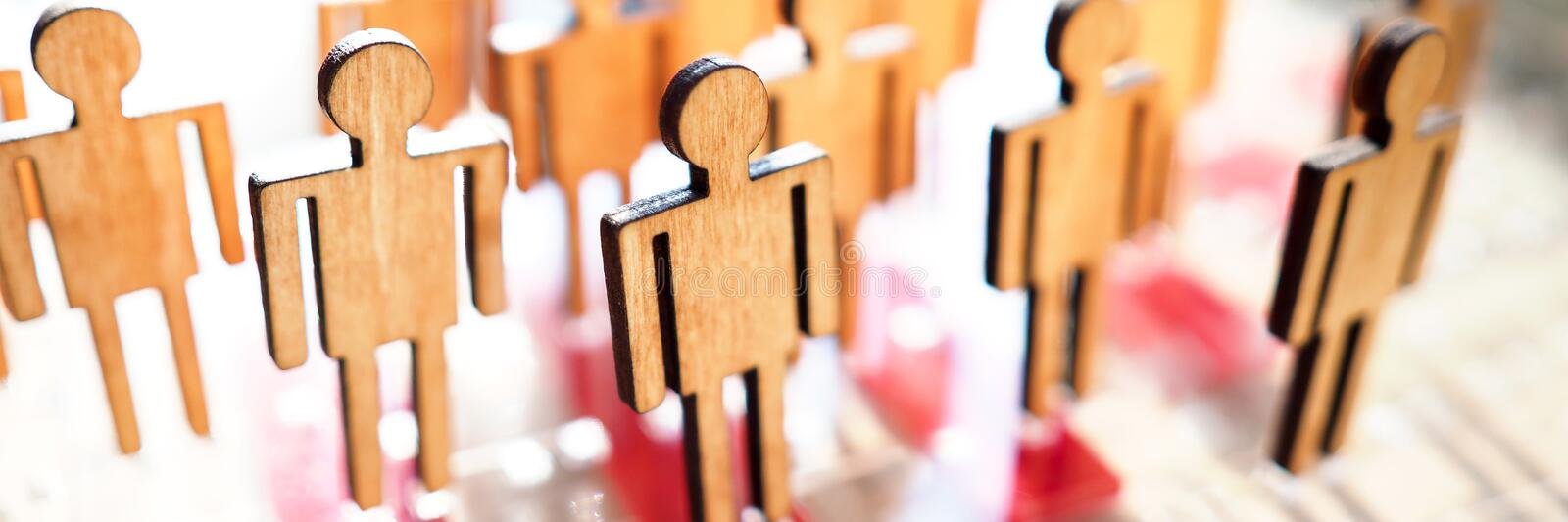 Little wooden toy people figures stand in row. Closeup. Teambuild hr poll net elector politics crowdfunding relationship labour talent public opinion concept royalty free stock images