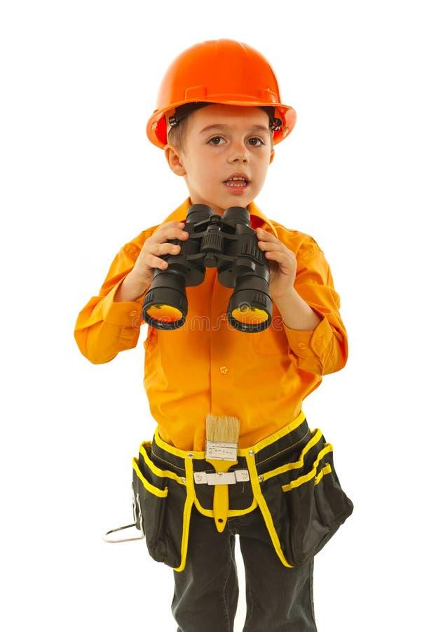 Little worker boy with binocular royalty free stock photos