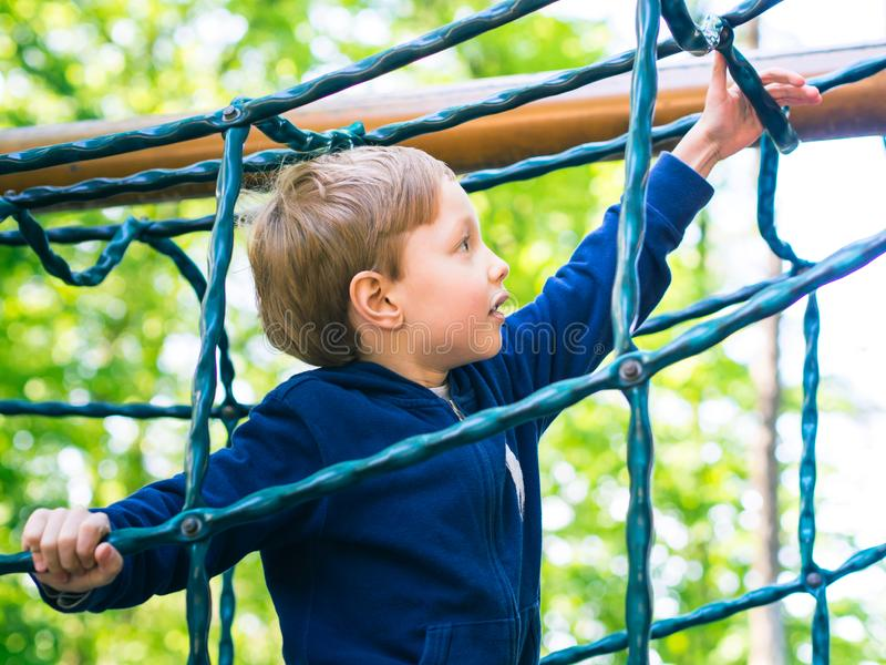 Little boy playing on a playground. Activity stock photos
