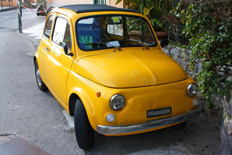 Little yellow fiat car. Little yellow retro fiat car standing on a street of Positano stock photography