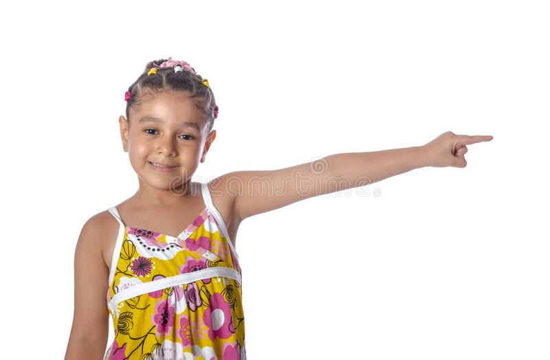 Little Young Beautiful Girl Pointing to Something, Copy Space, Isolated on White stock images