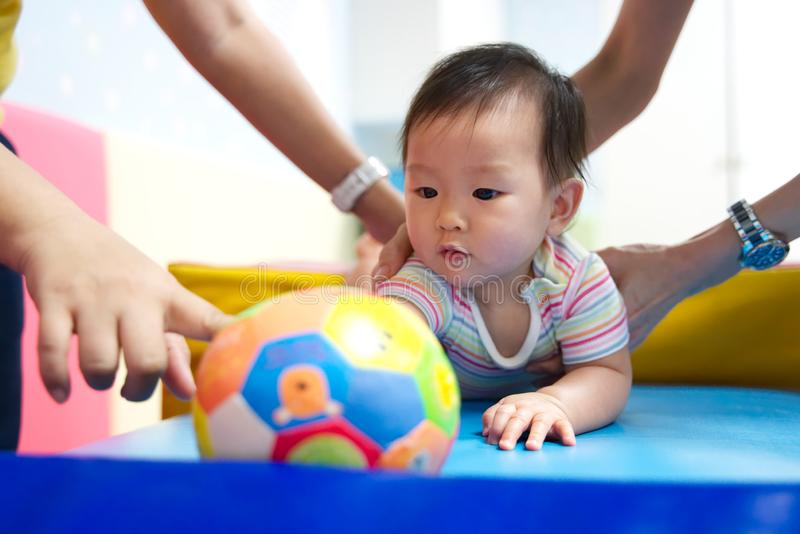 Little young kid learning in play and learn class with her mother. royalty free stock image