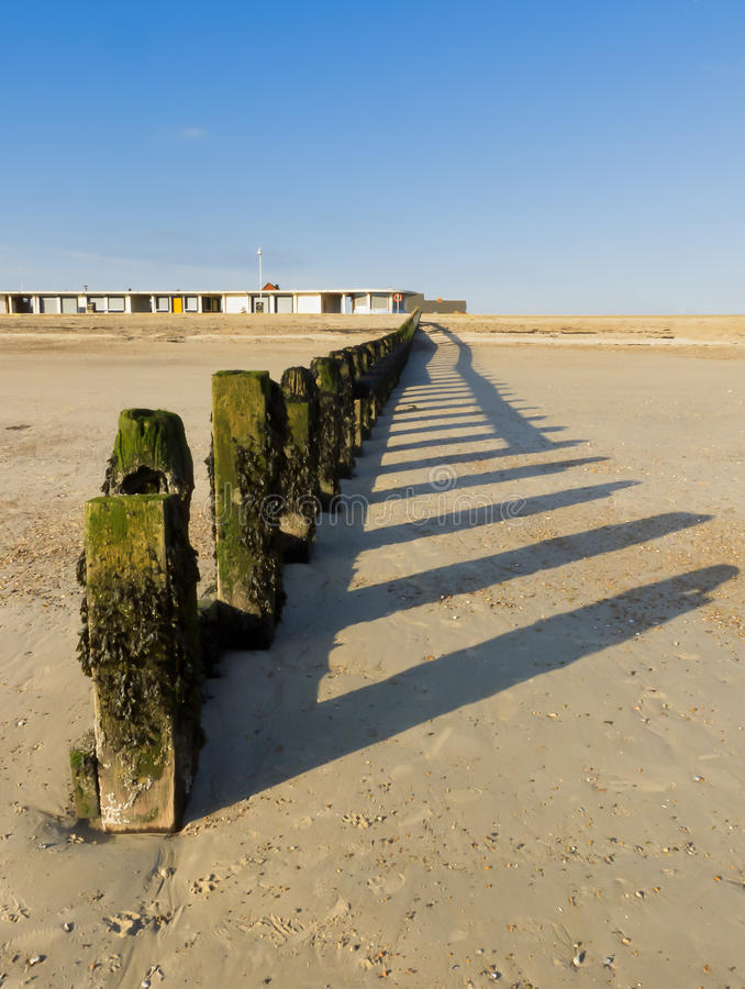 Littlehampton beach in winter. A groyne on Littlehampton, Sussex photographed looking towards the shore at low tide in Winter. Portrays the peace and solitude of royalty free stock photography
