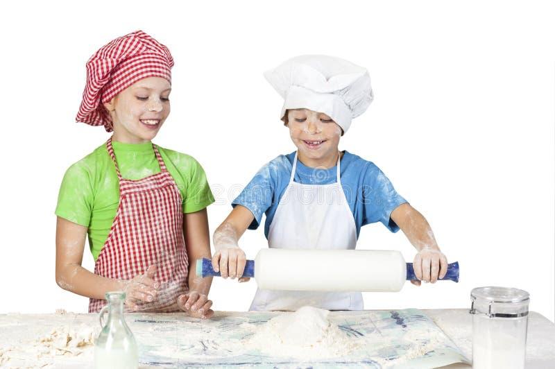 Littlle śmieszni piekarzi fotografia stock