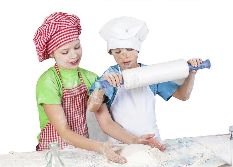 Littlle śmieszni piekarzi obrazy stock