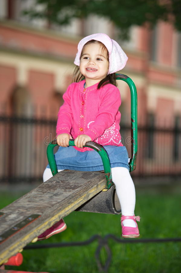 Litttle Girl At Playground royalty free stock photos