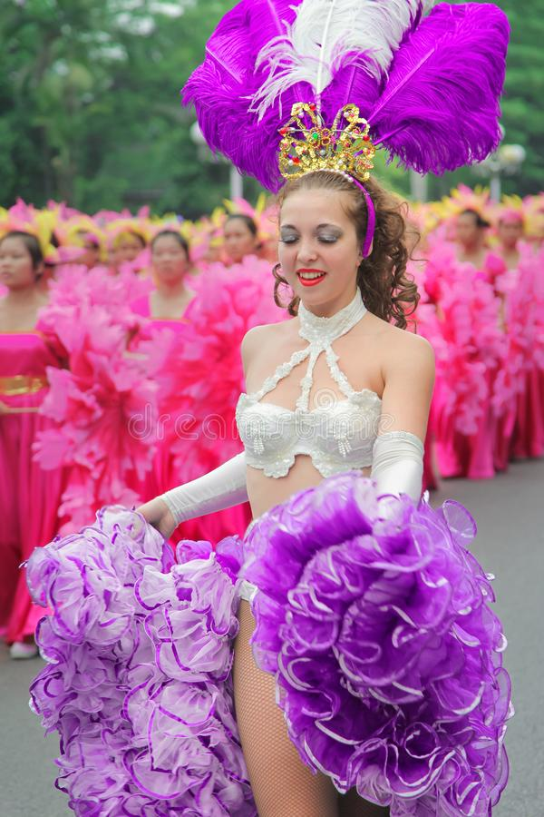 Carnival cabaret dancer wearing festival clothe with Ultra Violet style royalty free stock images