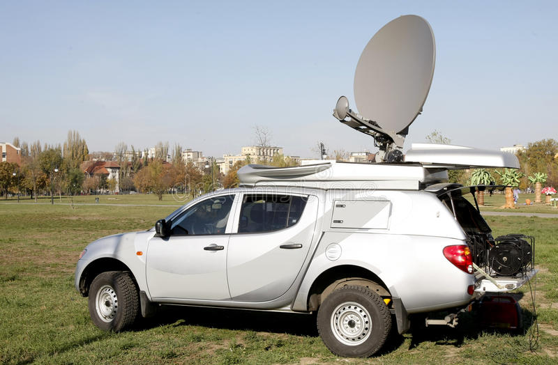 Live broadcast van. For a television is reporting news on site royalty free stock images