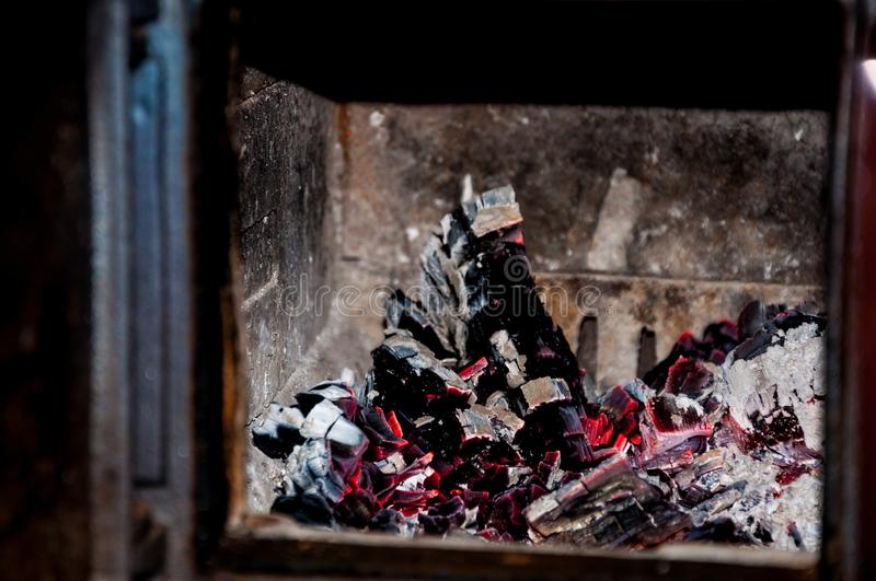 Live coals in the fire place stock photo