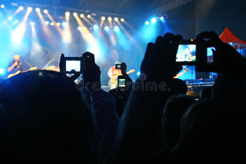 Live concert. Making photo during rock concert stock photo