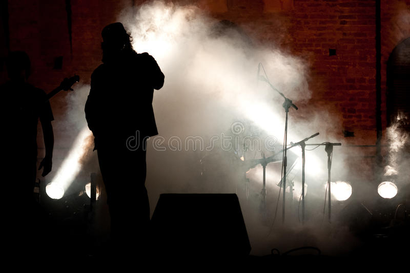 Live Concert siluette. In a summer night royalty free stock photography