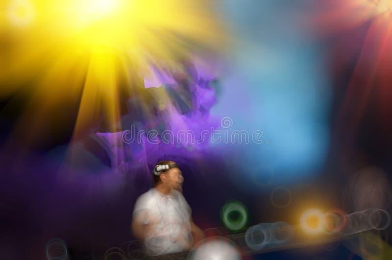 Live DJ. Blurred dark background, a live DJ in the disco stock photo