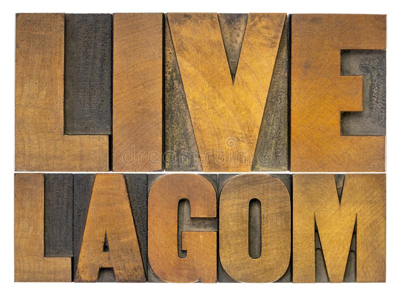 Live lagom word abstract in wood type stock images